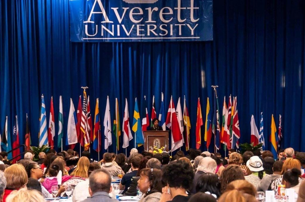 Dr. Shirley Davis speaking at a podium at Averett University